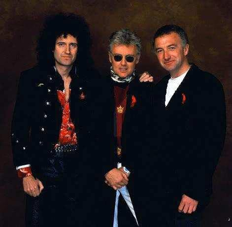 Freddie Mercury Tribute Concert - Wembley, April 1992 - This must be one of the last pictures of John Deacon with May and Taylor.