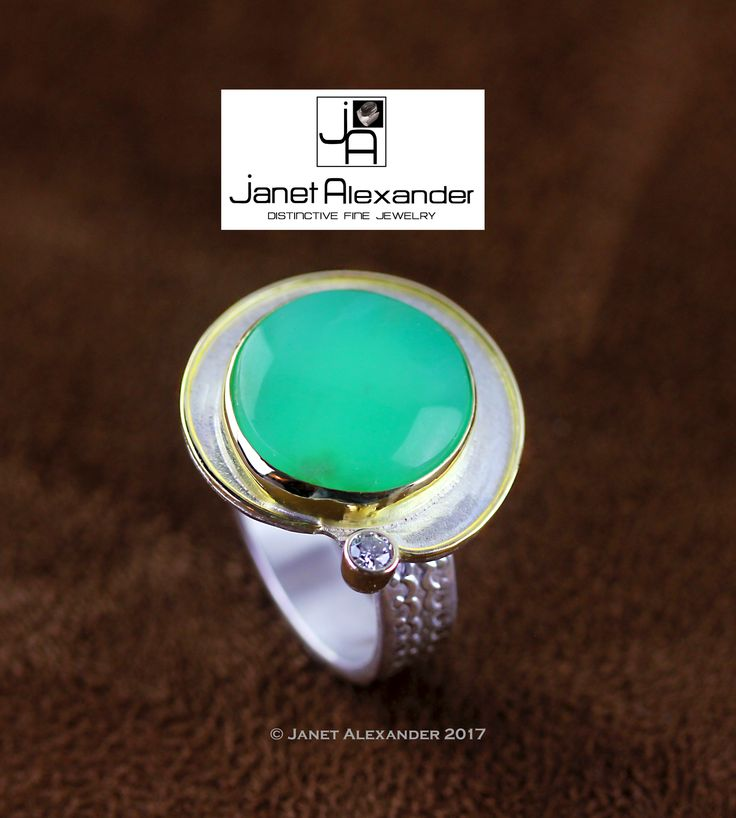 Argentium ring with18k gold accents and setting with round Chrysoprase gemstone accented with a 2.70mm I1 Diamond. The texture around the stone is imprinted into the metal with a rolling mill.