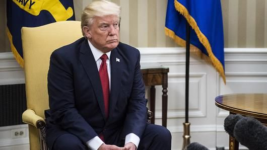 """TRUMP'S PROPOSED US OIL RESERVE SALE FEELS OPPORTUNISTIC, SAY CEO OF GLOBAL ENERGY FIRM."" photo: President Donald Trump meets with Colombian President Juan Manuel Santos in the Oval Office of the White House in Washington, DC on Thursday, May 18, 2017."