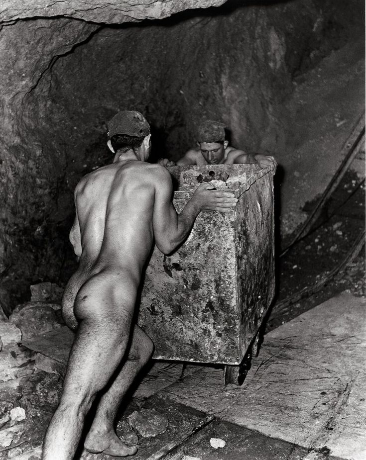 Fulvio Roiter: Solfatara, 1953. Miners working in a sulphur mine in Caltanissetta, Sicily. Forced to work naked in the sweltering heat as the clothes stuck to their skin.