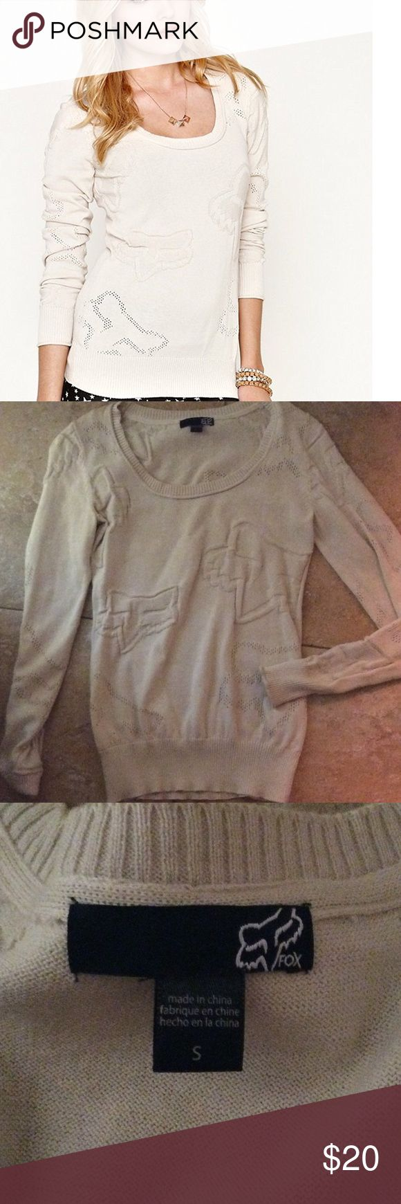 SM Cream Juniors Fox Sweater Never worn Fox Riders sweater. Soft cream sweater with Fox logo imprinted in fabric texture. Lightweight, and form fitting. True to size. Scoop necks don't work well for me, but it's a beautiful classy sweater in immaculate condition. You won't be able to tell it didn't come from a store. Fox Sweaters Crew & Scoop Necks