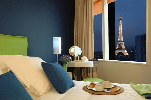 Breakfast in bed with a view like that? That's a good reason to visit France! **** Adagio Paris Tour Eiffel