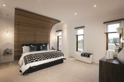 This contemporary master bedroom features a grey and stone palette with light timber feature wall. White walls and splashes of black in decor give a slightly masculine feel.