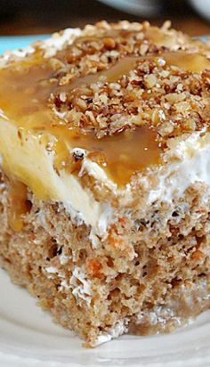 Carrot Cake Poke Cake _ The topping is a little special: it*s a sweet whipped combo of cream cheese, cool whip, & cool whip frosting. It*s topped with caramel sauce & chopped pecans, like any decent carrot cake should be!