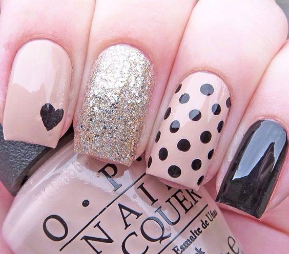 Classy nail art with polka dots and glitter