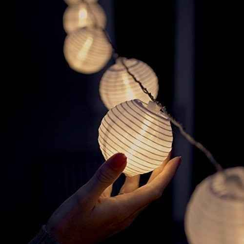 A string of solar-powered lanterns that work in rain or shine.