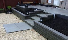 Tiered patio with flowerbed inlays.