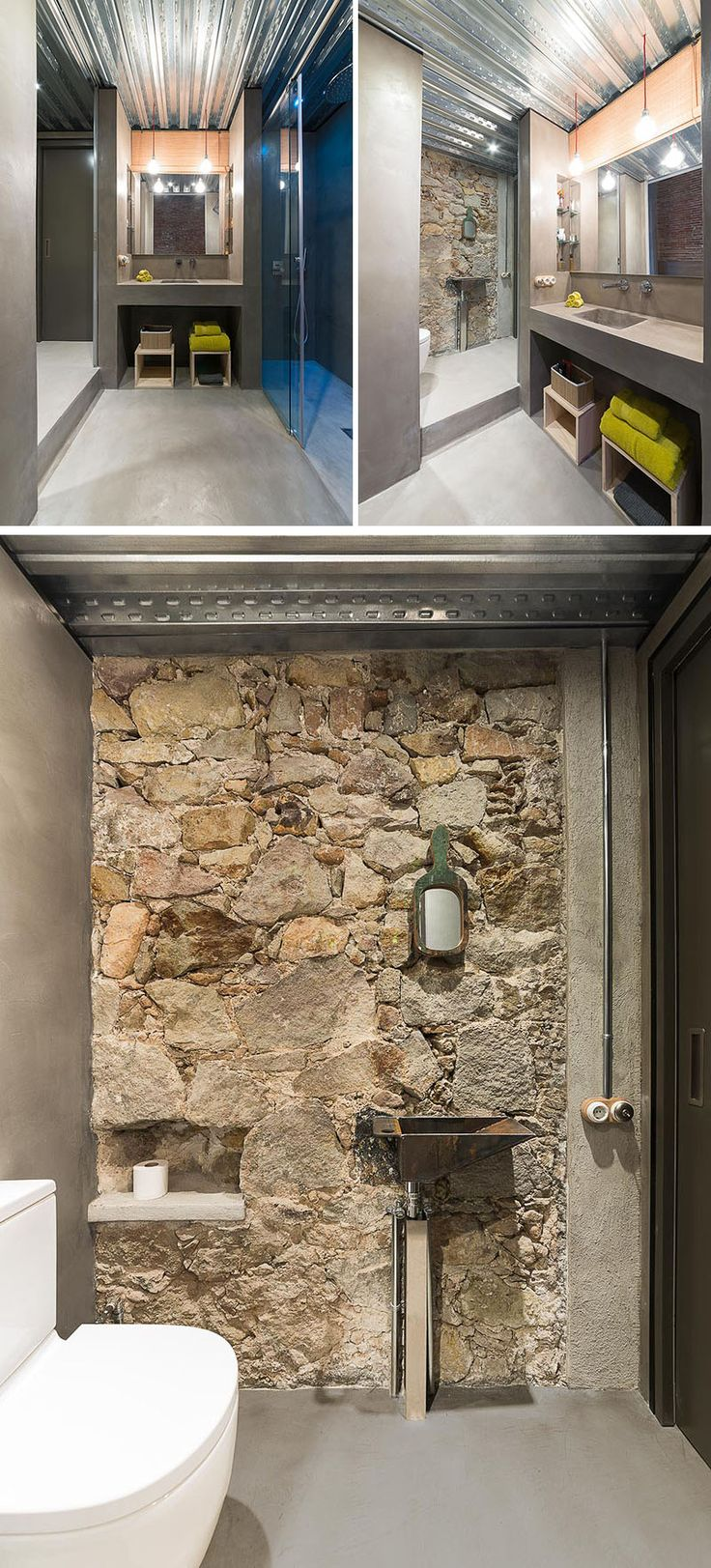 In this renovated bathroom, the vanity area and shower are stepped down from the toilet, and a metal ceiling helps to keep things bright. While the original stone wall has become a feature wall.