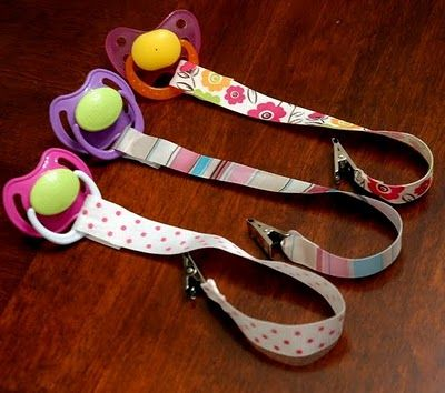 """HOW TO MAKE PACIFIER CLIPS - make 6-7"""" long. using Ribbon, Velcro, clips, hot glue gun.  I don't think there is any actual sewing involved."""