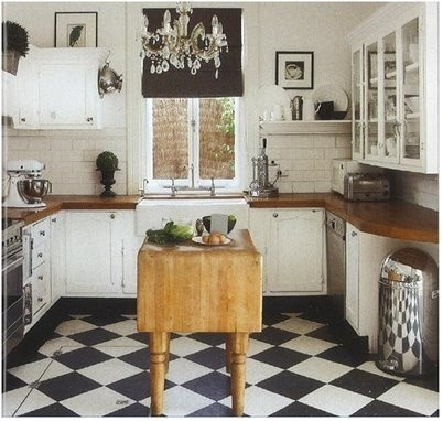 black and white kitchen floors are so romantic. Love the brown butcher block countertops also.