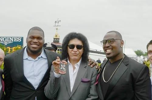 Raven Kelechi Osemele (second from left), Gene Simmons of KISS and Ravens players Arthur Jones, Justin Tucker and Michael Oher pose for a photo at the Preakness.