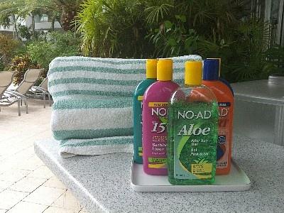 Beach Towels and Suntan Lotions