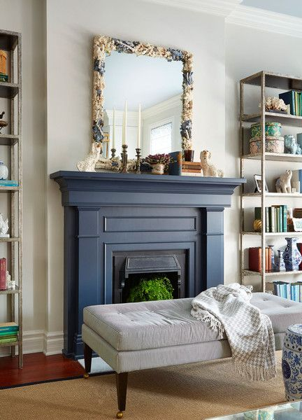 A Colorful, Neo-Trad Apartment in Chicago: A gray-striped cocktail bench faces a navy fireplace.