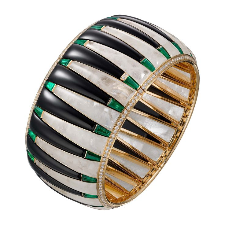 Étourdissant Cartier bracelet in 18k yellow gold, emeralds, rock crystal, onyx, and diamonds