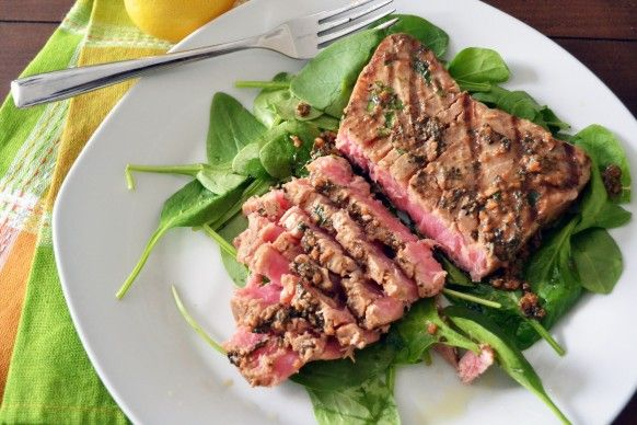 Tuna Steaks with Lime Cilantro Marinade. A simple and delicious way to make tuna steaks. Substitue coconut aminos for the soy sauce, and it's Paleo.