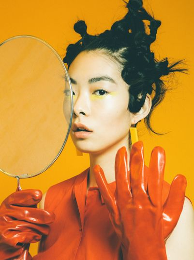 Rubber glove Rina by Alex De Mora.