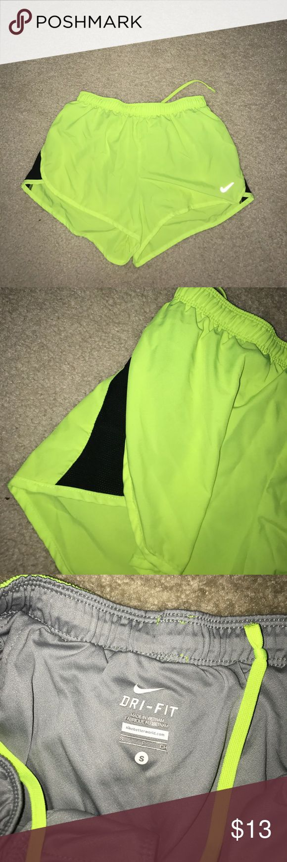 NEON YELLOW NIKE DRI-FIT RUNNING SHORTS Neon yellow Nike dri-fit running shorts. They have inner lining. Black stripe on the side. Size small. Nike Shorts