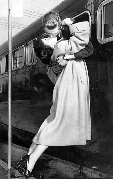 Vintage photography, Romantic Reunion (what you want to bet the train was still rolling to a stop, but these two simply couldn't be bothered.)