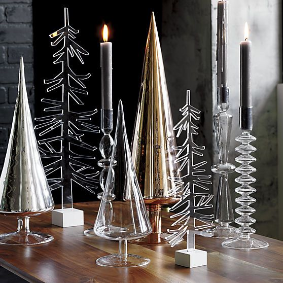 evergleam.  Handmade of ultra-durable beaker glass, slick cones trim the modern, minimalist tannenbaum.  Go for a modern forest in clear, white, silver or copper. For more modern holiday decorating ideas, check out Idea Central. Handmade beaker glassClear, white silver or copper finishWipe with clean, damp clothMade in China.