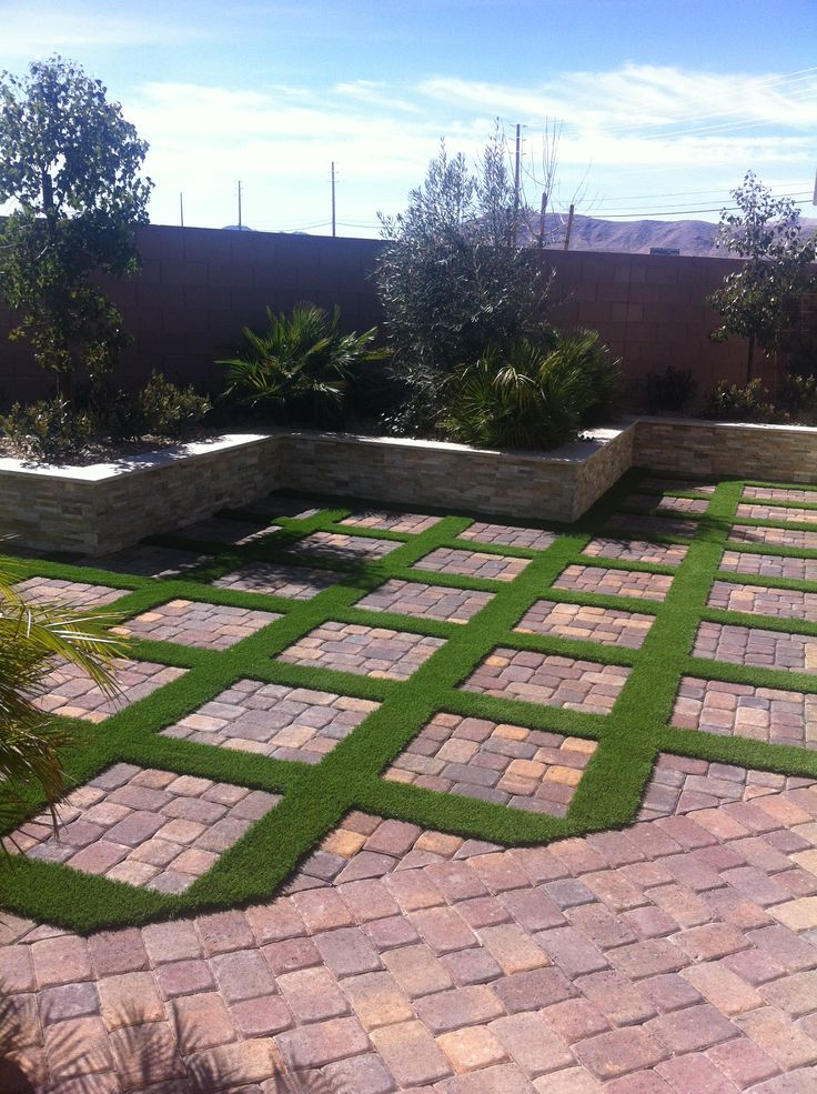 Sunset Oasis Landscapes in Las Vegas designed and built this low maintenance backyard for the green look without the hassle of mowing and watering the lawn! #desert #green #turf #artificialturf #landscaping #backyard #pavers