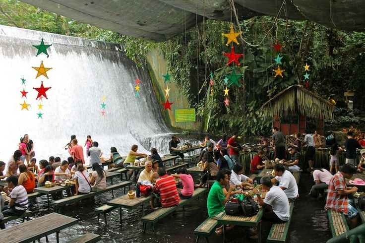 At the Labassin Waterfalls Restaurant in San Pablo City, the Philippines, lunch is served inches from the cascading water of an impressive set of falls.