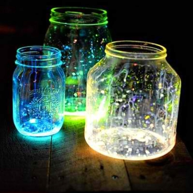 Glow in the dark paint splattered on mason jars. Cute party decor.