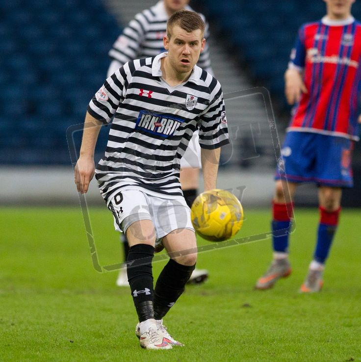 Queen's Park's Jamie McKernon keeps his eye on the ball during the SPFL League Two game between Queen's Park and Elgin City.