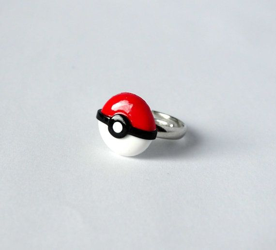 An adorable, geeky pokemon pokeball ring. It is adjustable so it fits around pretty much every finger!  It is 100% handmade from polymer clay