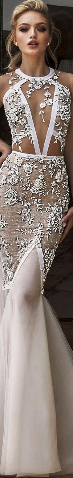 Dany Mizrachi Spring 2018 bridal sleeveless halter jewel neck keyhole neckline heavily embellished bodice elegant mermaid wedding dress keyhole back chapel train