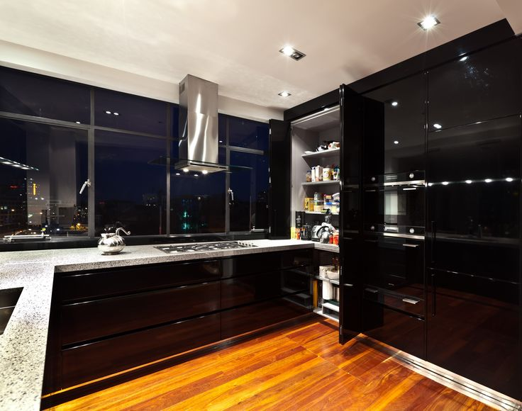 I did this ALL BLACK kitchen in an inner city penthouse for a client who has an amazing collection of NZ contemporary art.  http://maggiegardner.co.nz/