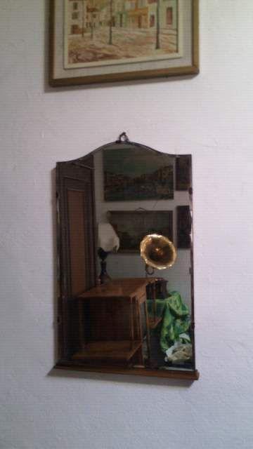 Specchio restaurato base in legno ,molato a mano cm 50*82 euro 80