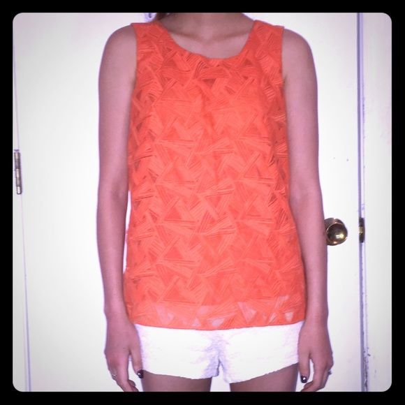Calvin Klein Orange Geometric Overlay Top Sz XS MASSIVE MOVING SALE!!  Make an offer! **Will be taking down many of my listings soon and selling them to my local consignment store!!** This is a lovely blouse from Calvin Klein with a comfortable jersey under layer and a stylishly boxy overlay with geometric patterns over the front of the top. Perfect for the summer and fall seasons! Pair it with super skinny jeans or a micro mini skirt for an unexpectedly sexy look! Purchased at Macy's for…