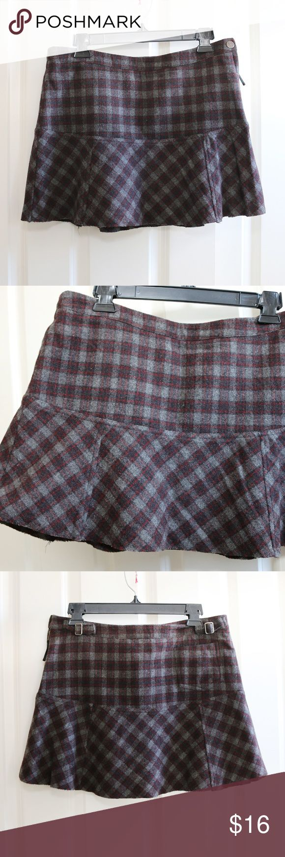 American Eagle Plaid Mini Skirt Size 8 American Eagle Outfitters plaid mini skirt.  Gray and red pattern.  Wool blend, lined.  Zipper and button on the side.  Size 8.  Waist is about 16 inches from side to side.  Length is about 14 inches.  NWT.  There is a tiny start of a hole on the back, see picture. American Eagle Outfitters Skirts Mini