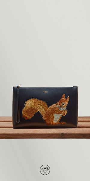 Shop the Squirrel Large Pouch in Midnight Smooth Leather at Mulberry.com. The detailed embroidery on this spacious pouch was inspired by Mulberry's roots in the English countryside. Crafted from smooth calf leather, it features one main compartment for storing essentials, embossed Mulberry tree lining and a leather zip wrist wrap.