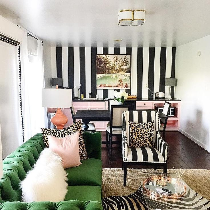 THIS WALLPAPER: Chic Office Boasts A Black And White Striped Accent Wall  Lined With Pink