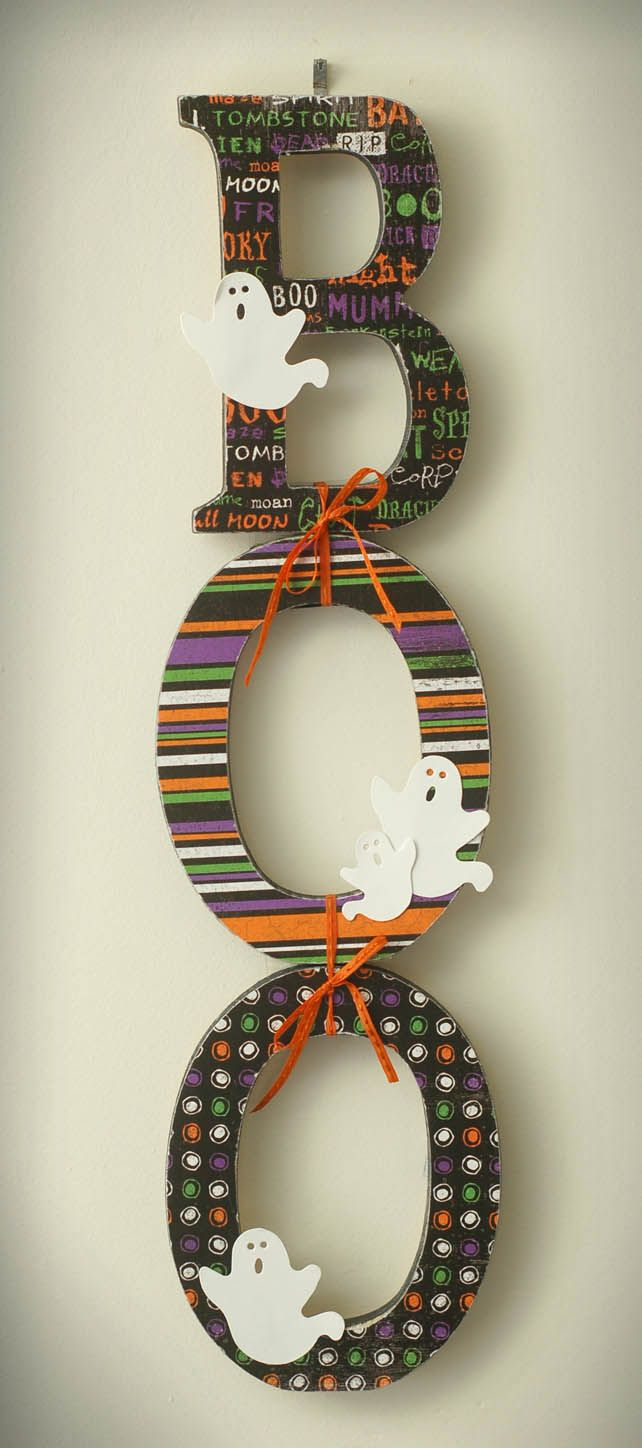"""Cute """"BOO"""" sign made with wood letters, scrapbook paper, and embellishments. Love the way they are tied together!"""