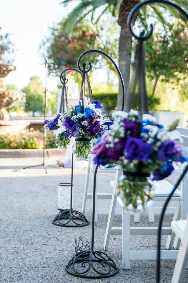A wonderful way to display flowers at an outdoor wedding reception.