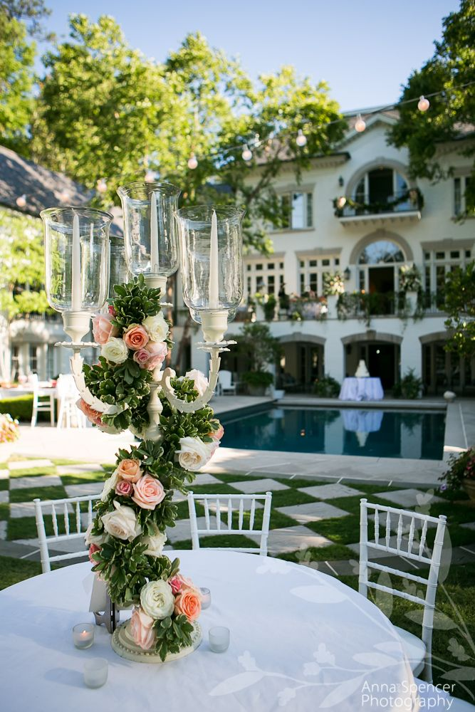 Anna and Spencer Photography, Atlanta Wedding Photographers. Outdoor summer backyard wedding reception. Tall pink and white rose floral candelabra centerpiece at an Atlanta Wedding. Parties to Die For Florist.
