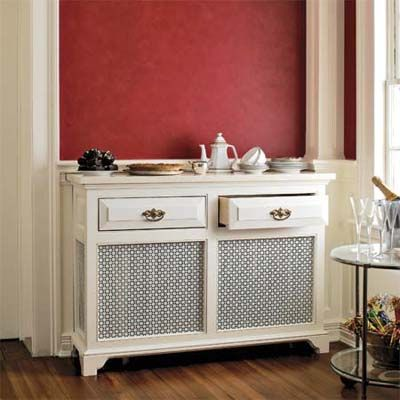 Photo: Steve Randazzo | thisoldhouse.com | from 24 Easy Upgrades to Create a Festive Holiday Home...clever idea! This is actually a cover over an old radiator to look like a buffet in a dining room