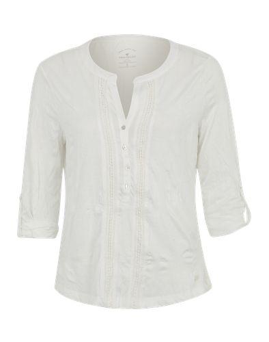 Blusenshirt mit Knopfleiste im romantischen Folklore-Look von Tom Tailor. Das Shirt ist aus wunderbar griffigem Material überzeugt durch seine Crinkle-Optik. Perfekt zum Hippie-Rock oder zur Boyfriend-Jeans.