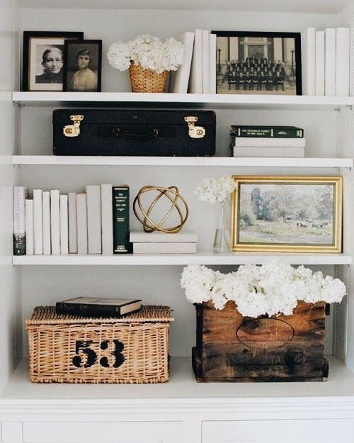 Bookshelf styling - neutral colors, texture, black & white photos