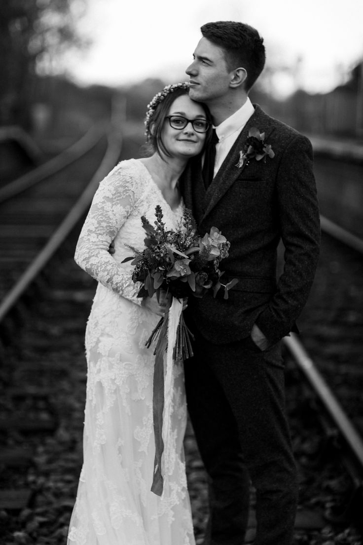 A perfect example of a black and white photography looking timeless. This could have been taken anytime in the past 100 years! Photo by Benjamin Stuart Photography #weddingphotography #blackandwhite #photography #brideandgroom #traintracks #justmarried #coupleshot #newlyweds