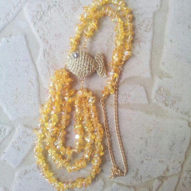 Toni del giallo ed oro per questa versione... il pesciolino lavorato a crochet