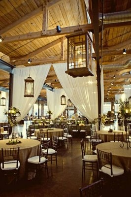 Rustic reception space with hanging lanterns