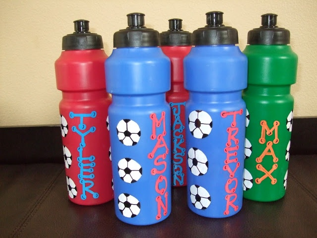 These are personalized party favors. They are standard water bottles painted with soccer balls and personalized with each child's name in paint.