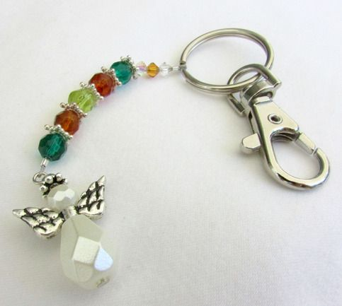This angel keychain is very sparkling with green and brown crystal beads and silver spacers throughout.   This makes a perfect affordable gift. Who doesn't need an angel to carry with them?    The angel bead dangles from the bottom, and the 1 inch metal ring has an attached metal hook for ea...