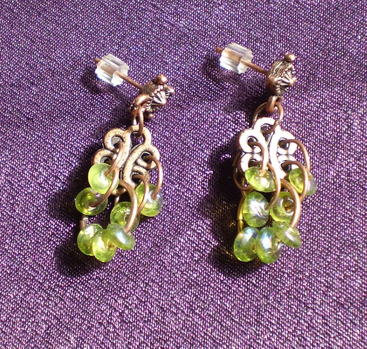 Cluster of small green glass rings on a copper knot by EachBeadCounts on Etsy