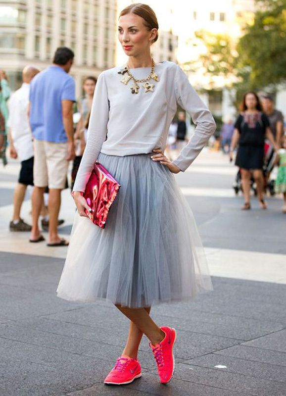 5 Ways To Dress Up Sneakers - neon pink sneakers and matching metallic pink clutch styled with a midi tutu organza skirt + casual top and gold, statement necklace