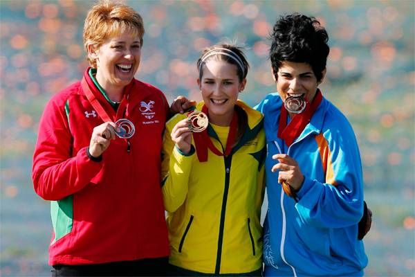 Wales' Elena Allen (left), Australia's Laura Coles (centre) and Cyprus' Andri Eleftheriou celebrate with their medals which they won in the women's skeet final. Glasgow Commonwealth Games 2014: Day 2- The Times of India