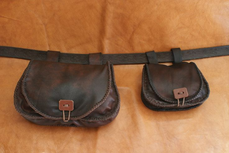 Matching leather belt pouches. by Henord